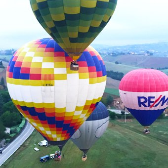 group-of-hot-air-balloons-takeoff-in-formation